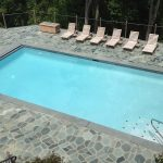 gunite-pool-with-automatic-cover-and-stone-deck